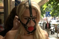 Slender blonde beauty is tied up, blindfolded, stripped, and fucked in public