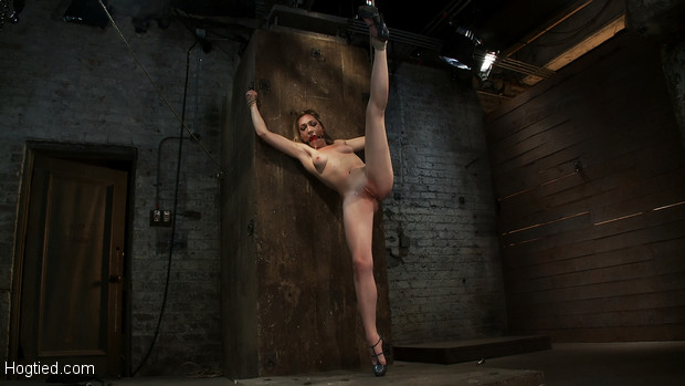 Tall leggy, blond is bound spread and helpless, made to cum over and over, gagged, and wrist suspended!