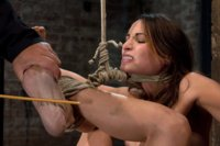 Cute girl suffers category 5 suspension, is made to cum and has a huge plug jammed in her ass.  Hung by only neck and ankles, and cumming like a slut.
