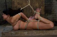 Sexy Hawaiian is brutally hogtied,  elbows bound together, hair tied to feet, suffering orgasm after orgasm until she is lying in her own squirt.