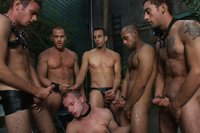 A sexy stud is stripped naked, humiliated and gang fucked in front of a cheering crowd.