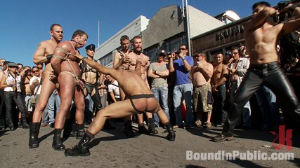 Folsom street trash. A lustful stud is stripped naked, humiliated and gang fuck in front of a cheering crowd.
