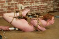 Crysta Sarah makes noises of appreciation as she is tied.