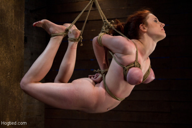 Hot 19 yr old suffers a category 5 Hogtied suspension. Isis Love makes her cum over and over while she is helpless to resist!  This girl has huge tits