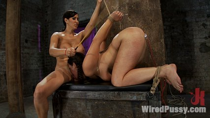 Local model explores her kinky side. Curvy brunette gets hung upside down tickled, shocked with electricity, and made to lick kitty in lesbian BDSM scene