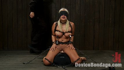 Chain slut. Kait Snow and her large lovely butt and tits are chained down on the Sybian for some severe punishment and orgasms.