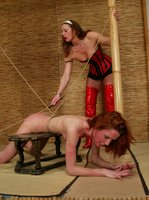Kitty punished by Kym, lift/carry, hotwax, caning, tit torture