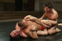 Two big dicked studs take on a cocky muscle stud in a sex crazed oil match.