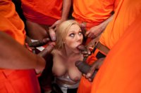 Samantha Sin is a sexy prison warden who gets cuffed by her inmates and made to suck cock and get fucked in every hole. Hot interracial action!