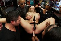 Boxcover star Krissy Lynn pleases the horny patrons of a sex shop  - she gets ass fucked, finger and stuffed full of dick while everyone gropes her.