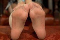 Footslave is made to worship, sniff and clean two hot dominatrix sweaty beautiful feet while spanked and enduring CBT with a final kinky footjob.