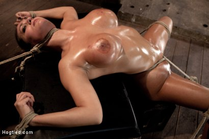 Sexy-tan-oiled-blond-is-slowly-dragged-into-the-darkness-by-a-neck-rope-Made-to-cum-over-and-over