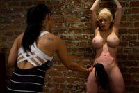 Isis Love dominates and fucks her sexy neighbor in a racy lesbian affair filled with bdsm and kinky sex.