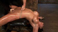 Cute girl with massive tits is severely bound arched, oiled. Pussy flogged, fingered, made to cum over & over.  Hair tied to crotch rope in the end.