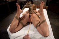 Hot Blonde Audrey Rose struggles as she cums again and again in tight hogtie. Pussy hook, ring gag, and caning keep her in her place.