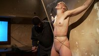 Tall long legged blond is held in a creepy room by masked man. She's bound to wall, abused with crotch rope, and made to squirt.