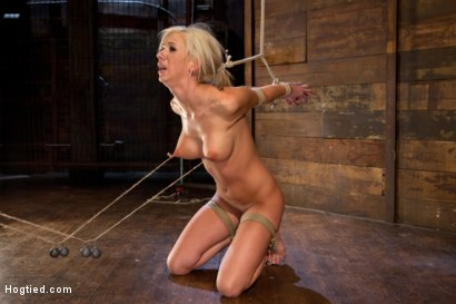 Hot blonde with big tits & braces, has elbows bound, is gagged. Nipples are tied to a post with weights hanging, made to cum over & over.  So helpless