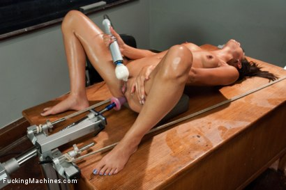 Sexy tall brunette cums in her own face from a squirting pile driving machine fuck - gets her ass rammed by machines and squirts some more.