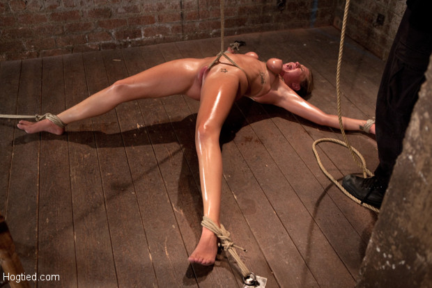 19yr old blond is bound, oiled, has massive orgasms ripped from her helpless body. Brutal breast bondage & a crotch rope that lifts her off the ground