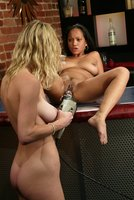 Two hot and wet girls fuck each other with machines.