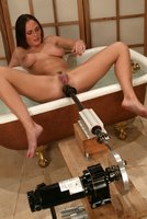 Beautiful Venus fucks a machine in the bathroom.