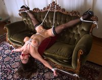 Sexy Jewell Marceau is tied to the couch.