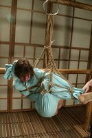 Maria Shadoes, Bridgett Harrington, and Teager in Hogtied.