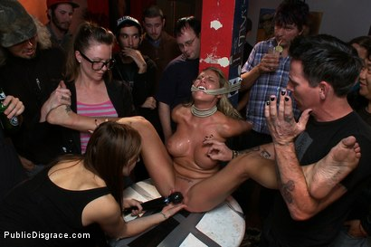 Charisma Cappelli gets down and dirty in a public bar. Tied up and fucked hard in the ass she squirts all over the floor and is made to lick it up!