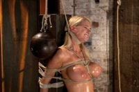 Amazing blond with HUGE tits, bound to a chair. Impaled with a huge dildo with a vibrator stuck right on her clit. Breath control makes this girl cum!