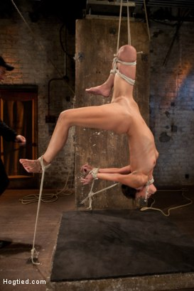 Tiny flexible brunette suffers a Category 5 suspension while being made to cum over and over, nipple clamps and weights torture her huge nipples.