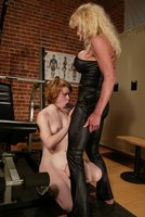 Redhead cutie gets a good caning in the gym