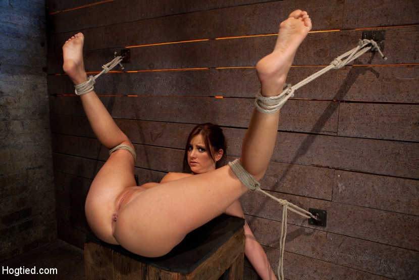 Bent naked and tied with legs wide