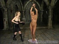 Sexy girl shackled  in the dungeon, stripped and whipped