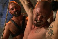 Muscle daddy suspends his ripped boy in the dungeon and fucks the hell out of him.
