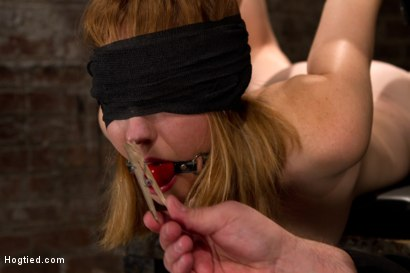 Sgt. ties this bitch good. Finger fucking her and spanking her pristine ass, he makes her cum leaves her to suffer suspended in an extreme back arch.