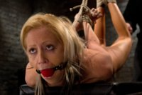 Hot flexible blond suffers a brutal Category 5 suspension. Anal hook, tight gag, heavy nipple weights, made to cum over and over.  Caned, & abused!