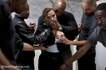 Katja Kassin is overpowered in the men's room by strong black men. Bound, fucked in every hole, and left in the urinal with a cum covered face!