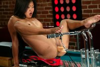 Sexy Asian babe fucks the machines in the bar.