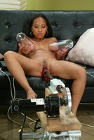 Sexy Asain girl fucks a machine DP, and big red on The Intruder.