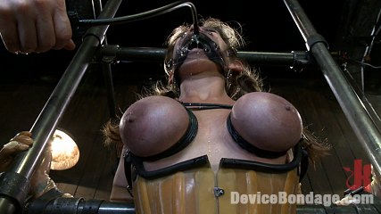 Felony bound in elegant latex metal and leather bondage. We get to see Felony bound in cruel metal and ballet boots, elaborate latex with all orifices plugged, and back bending metal and leather bondage!