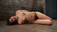 Bound in a box tie with one leg to the ceiling, Cassandra Nix is made to eat ass, suck cock, endure foot caning, pussy flogging, and a crotch rope!