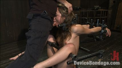 Kristina rose  filthy whore  live show part 3. Kristina Rose is bound into metal pipe with her knees to chest and arms in strappado. Maestro fucks her face and JP torments her with rubber bands.