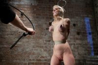 Cherry Torn Live Show Part 1 - Cherry is suspended by her breasts / elbows / crotch rope and worked over hard with the single tail and nipple clamps.