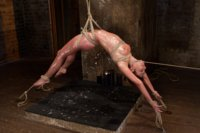 Completely vulnerable Amber Rayne is drawn and quartered in a back breaking arched suspension by her hips with a cruel crotch rope and lots of cum.