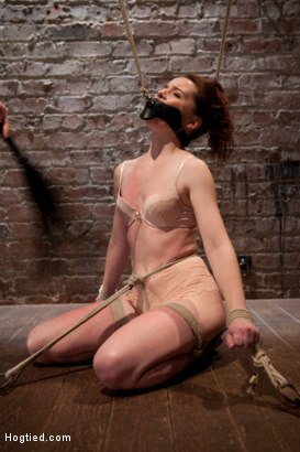 Red head and tiny AnnaBelle Lee is tied with her gag and hair pulling in two directions. Helpless and horny, we get to violate her sensitive body.