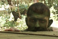 Madman Ricky Sinz torments Tyler Alexander and Morgan Black deep in the woods.