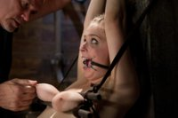 Young Penny Pax loves the pain as she is strung up in extreme ties. Mark Davis canes her feet, spits on her, slaps, flogs and face fucks her throat.