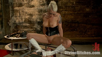 Blonde is making her sub happy with a number of chastity cages put around his cock and balls