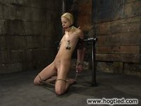 Morgan March recieves extreme torture in Hogtied.