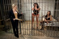 Two locked up prostitutes give the lesbian officer kinky favors to get out of jail including drinking lactating breasts!